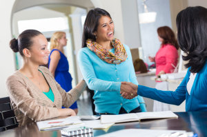 women-shaking-hands - making the right connections